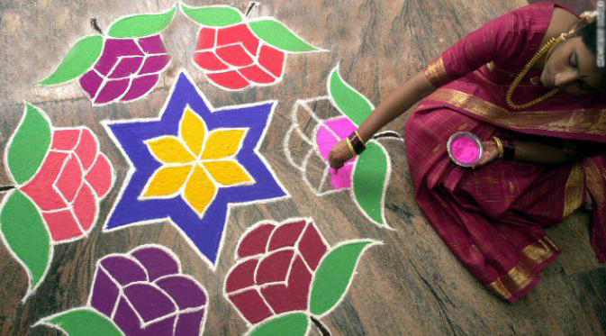 diwali-celebrates-rangoli-woman-horizontal-gallery